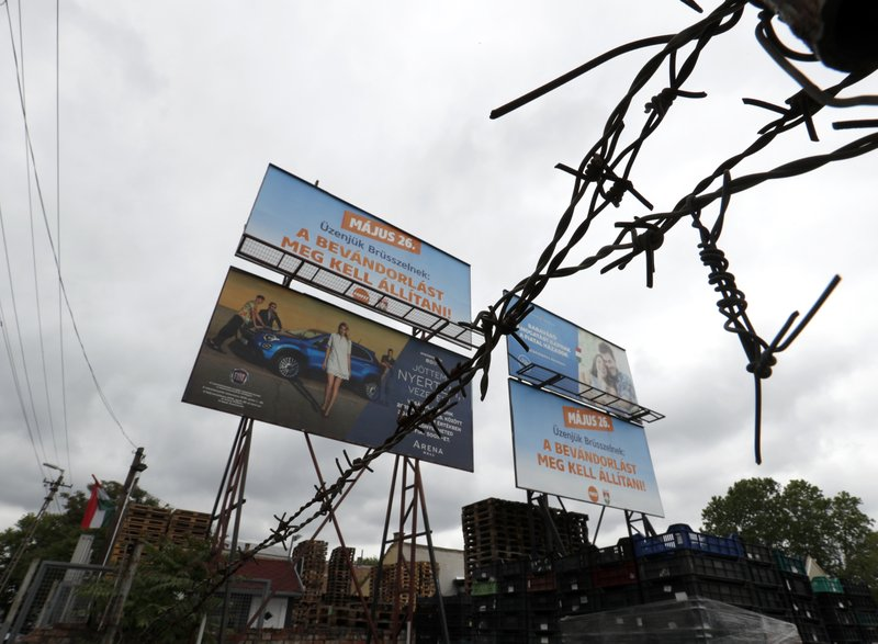"Two campaign billboards, top left and bottom right, from the ruling Fidesz party that read: ""Our message to Brussels: Immigration must be stopped,"" are displayed next to a campaign poster, top right, by the Hungarian government to boost the country's birthrate, in Budapest, Hungary, May 16, 2019, ahead of the European election on May 26. Given just five minutes to present their European Parliament election campaigns on Hungary's state media, opposition parties have been using their meager opportunities in novel and creative ways. (AP Photo/Laszlo Balogh)"