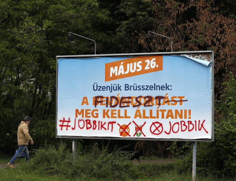 "A billboard for Hungary's ruling Fidesz party that reads: ""Our message to Brussels: Immigration must be stopped"", is written over expressing support for the Jobbik party, in Budapest, Hungary, May 16, 2019, ahead of the European election on May 26. Given just five minutes to present their European Parliament election campaigns on Hungary's state media, opposition parties have been using their meager opportunities in novel and creative ways. (AP Photo/Laszlo Balogh)"