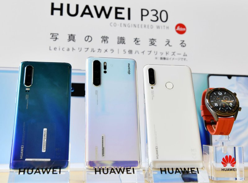 In this May 21, 2019, photo, Huwaei's new products are on display during a news conference in Tokyo. Two Japanese mobile carriers are delaying the sale of new smartphones from Huawei as they confirm the safety of the Chinese products. (Ren Onuma/Kyodo News via AP)