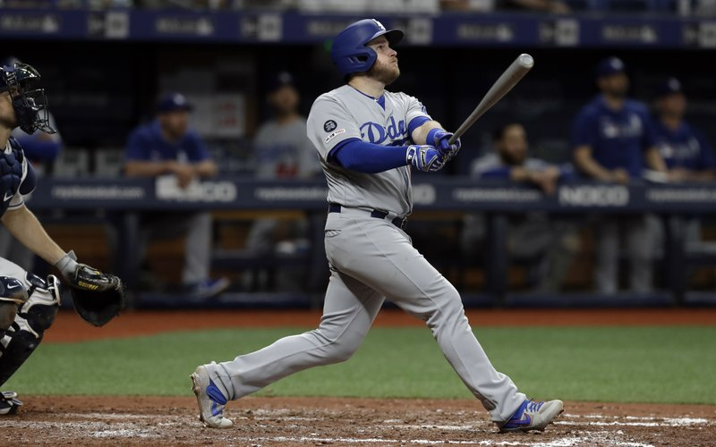 Los Angeles Dodgers' Max Muncy watches his sixth-inning home run off Tampa Bay Rays relief pitcher Yonny Chirinos during the sixth inning of a baseball game Wednesday, May 22, 2019, in St. Petersburg, Fla. (AP Photo/Chris O'Meara)