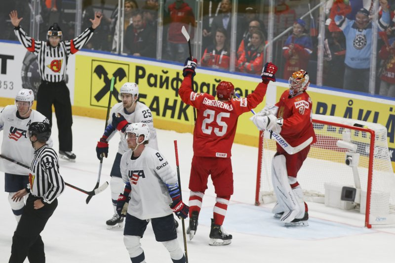 Russian players celebrate at the end of the Ice Hockey World Championships quarterfinal match between Russia and the United States at the Steel Arena in Bratislava, Slovakia, Thursday, May 23, 2019. (AP Photo/Ronald Zak)