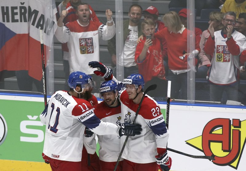 Czech Republic's Jan Kovar, second from right, celebrates with team mates after scoring his side's fifth goal during the Ice Hockey World Championships quarterfinal match between Germany and the Czech Republic at the Steel Arena in Bratislava, Slovakia, Thursday, May 23, 2019. (AP Photo/Ronald Zak)