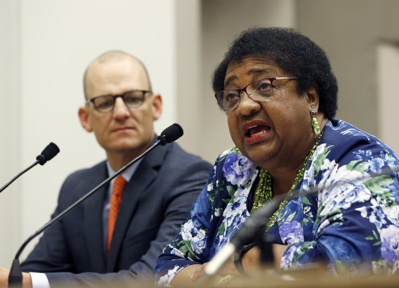 FILE - In this April 9, 2019 file photo Assemblywoman Shirley Weber, D-San Diego, discusses her proposed measure to limit the use of deadly force by police, as the bill's co-author, Assemblyman Kevin McCarty, D-Sacramento, left, listens during a hearing on the bill at the Capitol, in Sacramento, Calif. Major police organizations confirmed Thursday, May 23 2019, that they won't fight her bill, AB392, that would bar police from using lethal force unless it is necessary to prevent immediate harm to themselves or others. (AP Photo/Rich Pedroncelli, File)