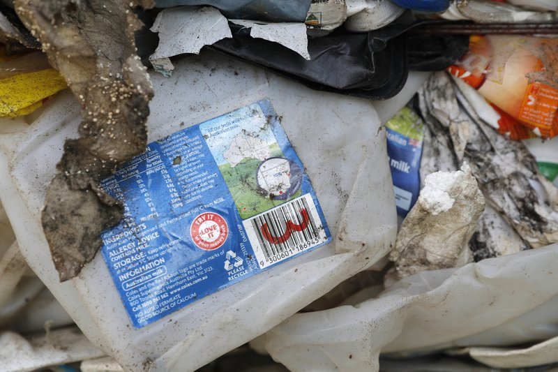 Non-recyclable plastic found inside a container from Australia is detained by authorities at the west port in Klang, Malaysia, Tuesday, May 28, 2019. Malaysia environment minister Yeo Bee Yin says Malaysia has become a dumping ground for the world's plastic waste and the country has begun sending non-recyclable plastic scrap to the developed countries of origin. (AP Photo/Vincent Thian)