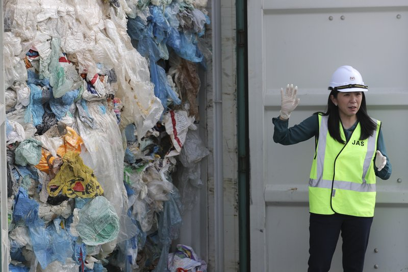 Malaysia's Minister of Energy, Science, Technology, Environment and Climate Change Yeo Bee Yin shows plastic waste shipment in Port Klang, Malaysia, Tuesday, May 28, 2019. Malaysia says it will send back some 3,000 metric tonnes (330 tons) of non-recyclable plastic waste to countries including the U.S., U.K., Canada and Australia in a move to avoid becoming a dumping ground for rich nations. (AP Photo / Vincent Thian)