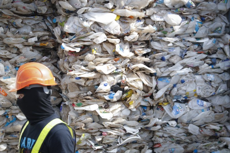 A container is filled with plastic waste from Australia, in Port Klang, Malaysia, Tuesday, May 28, 2019. Malaysia says it will send back some 3,000 metric tonnes (330 tons) of non-recyclable plastic waste to countries including the U.S., U.K., Canada and Australia in a move to avoid becoming a dumping ground for rich nations. (AP Photo / Vincent Thian)
