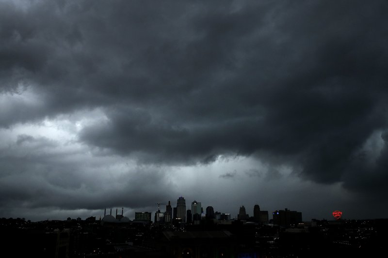 A severe storm that dropped several tornados earlier passes behind downtown Kansas City, Mo. Tuesday, May 28, 2019. (AP Photo/Charlie Riedel)