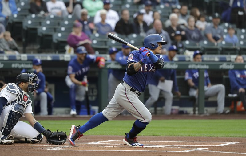 Texas Rangers' Shin-Soo Choo follows through on a single during the first inning of a baseball game against the Seattle Mariners, Tuesday, May 28, 2019, in Seattle. (AP Photo/Ted S. Warren)