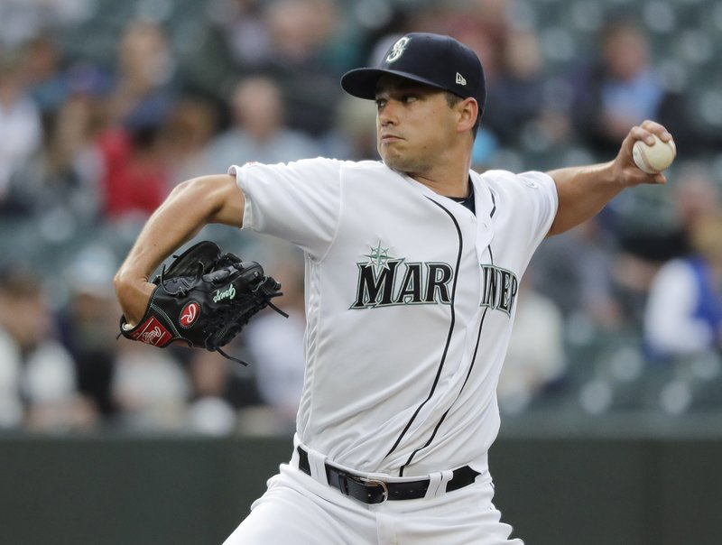 Seattle Mariners starting pitcher Marco Gonzales throws against the Texas Rangers during the first inning of a baseball game, Tuesday, May 28, 2019, in Seattle. (AP Photo/Ted S. Warren)