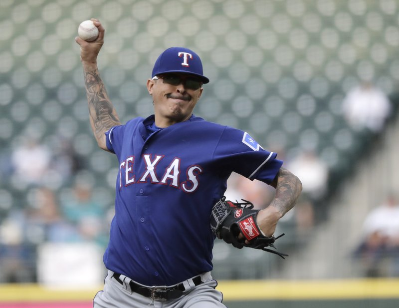Texas Rangers pitcher Jesse Chavez throws during the first inning of a baseball game against the Seattle Mariners, Tuesday, May 28, 2019, in Seattle. (AP Photo/Ted S. Warren)