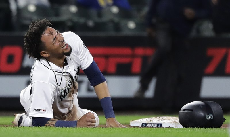 Seattle Mariners' J.P. Crawford reacts after an injury in the eighth inning of a baseball game against the Texas Rangers, Tuesday, May 28, 2019, in Seattle. The Rangers won 11-4. (AP Photo/Ted S. Warren)