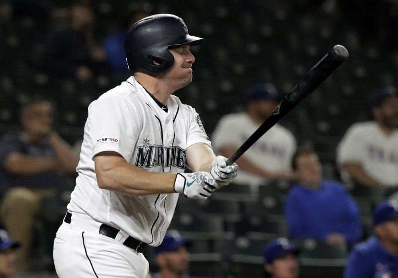 Seattle Mariners' Jay Bruce reacts after flying out against the Texas Rangers during the eighth inning of a baseball game, Tuesday, May 28, 2019, in Seattle. The Rangers won 11-4. (AP Photo/Ted S. Warren)