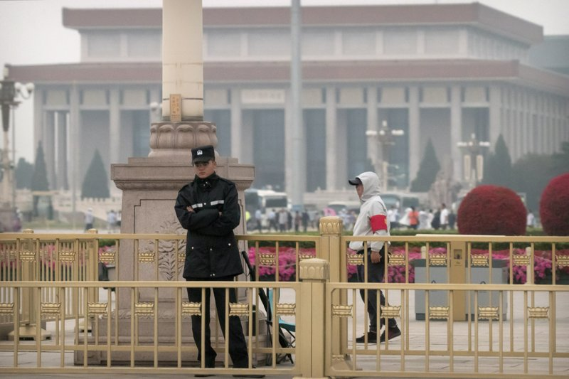 Security officials stand guard on Tiananmen Square in Beijing, Tuesday, June 4, 2019. Chinese authorities stepped up security Tuesday around Tiananmen Square in central Beijing, a reminder of the government's attempts to quash any memories of a bloody crackdown on pro-democracy protests 30 years ago. (AP Photo/Mark Schiefelbein)