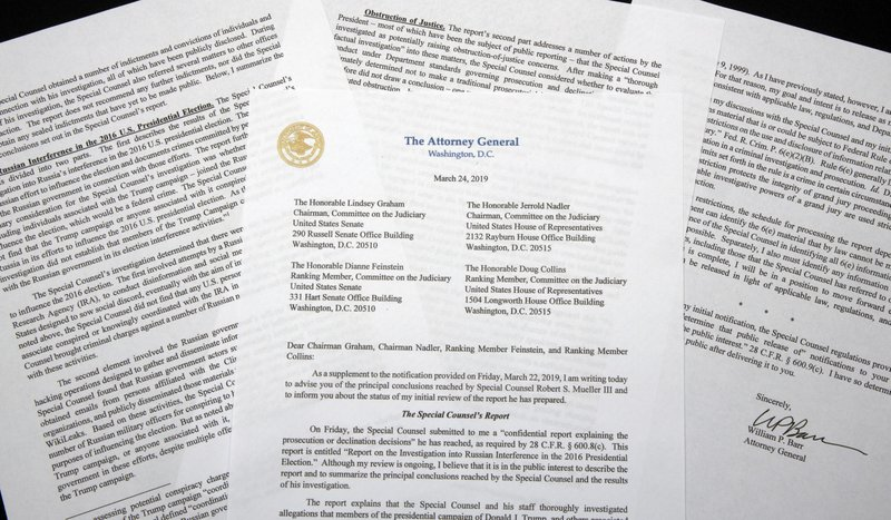 FILE - In this March 24, 2019, file photo, a copy of a letter from Attorney General William Barr advising Congress of the principal conclusions reached by special counsel Robert Mueller, is photographed in Washington. Barr is defending his short summary of special counsel Robert Mueller's report on his Russia investigation. Barr says his summary accurately captured the report's conclusions. (AP Photo/Jon Elswick, File)