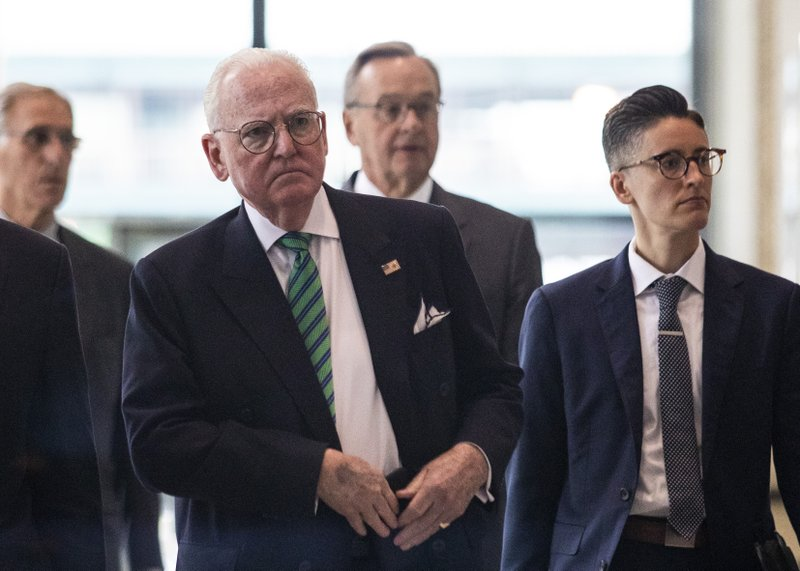 Alderman Edward M. Burke, left, flanked by his attorneys, walks out of the Dirksen Federal Courthouse, Tuesday, June 4, 2019, in Chicago. Burke pleaded not guilty to federal political corruption charges. (Ashlee Rezin/Chicago Sun-Times via AP)