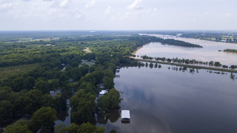 This aerial photo shows flooding along the Arkansas River in Pine Bluff, Ark., Tuesday, June 4, 2019. The economically struggling Arkansas city in the midst of a revitalization plan continued flooding Tuesday as the Arkansas River crested its banks, but local officials said even after the waters recede, the community's resilience will bolster recovery. (DroneBase via AP)