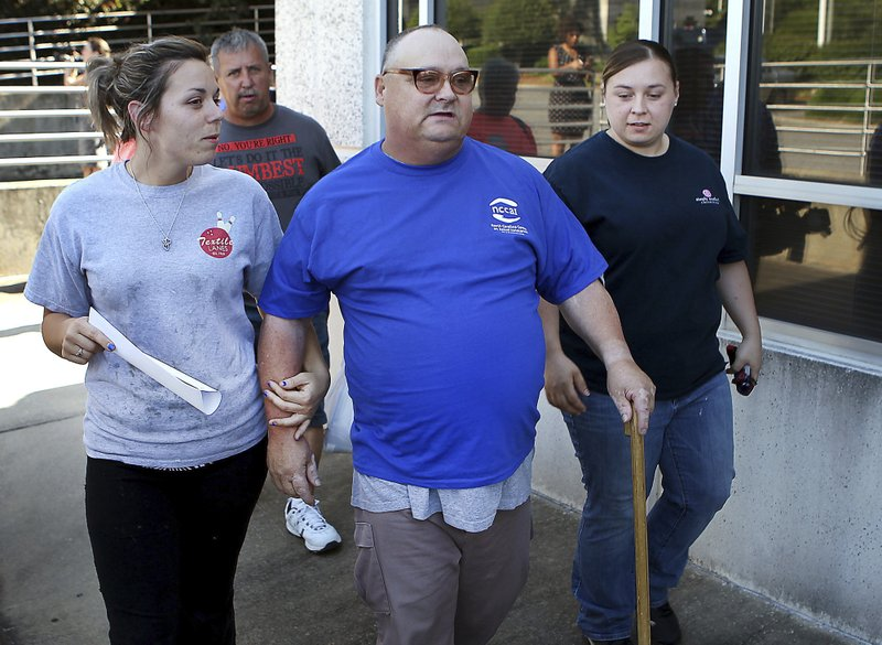 Mark Carver walks with family members after he was released from the Gaston County Jail in Gastonia, N.C., Tuesday, June 11, 2019, on bond pending his new trial for the 2008 murder of Ira Yarmolenko. (John Clark/The Gaston Gazette via AP)