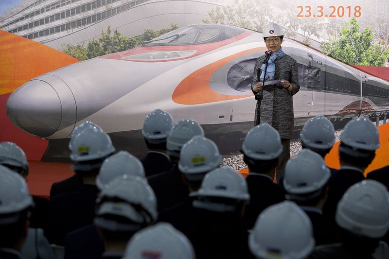 In this Friday, March 23, 2018, file photo, Hong Kong Chief Executive Carrie Lam speaks during the Main Works Completion Ceremony of the Express Rail Link Hong Kong section in West Kowloon terminus of Hong Kong. A high-speed rail link opens between Hong Kong and mainland China. Passengers clear Chinese immigration inside the station in Hong Kong, raising protest from some opposition lawmakers that Chinese law would apply in the immigration area. (AP Photo/Kin Cheung, File)