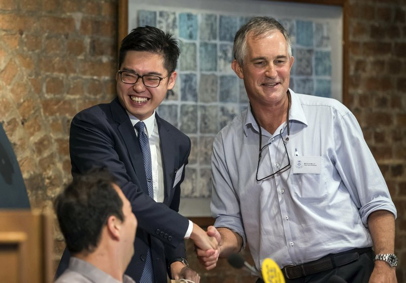 In this Aug. 14, 2018, file photo, The Financial Times Asia news editor, Victor Mallet, right, shakes hands with Andy Chan, founder of the Hong Kong National Party, during a luncheon at the Foreign Correspondents Club in Hong Kong. Hong Kong-based Financial Times editor Victor Mallet has his application to renew his work visa rejected. Authorities won't say why, but comes after Mallet introduced the leader of the Hong Kong National Party at a Foreign Correspondents' Club event in August. (Pool Photo via AP, File)