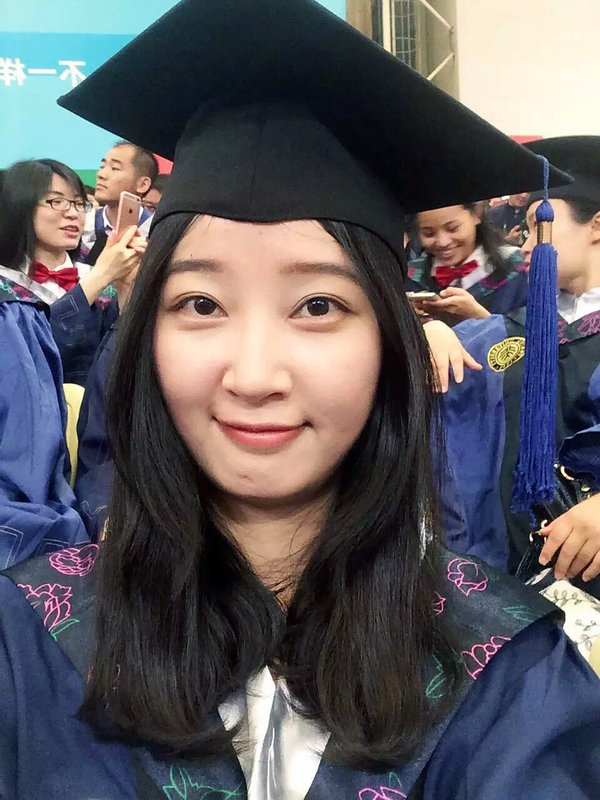 FILE - This 2016 selfie provided by her family shows Yingying Zhang in a cap and gown for her graduate degree in environmental engineering from Peking University Shenzhen Graduate School. The 26-year-old visiting scholar at the University of Illinois at Urbana-Champaign, disappeared June 9, 2017. Brendt Christensen, a former graduate student, has been charged with kidnapping and killing her. Zhang's body has not been found. (Zhang Family Photo via AP, File)