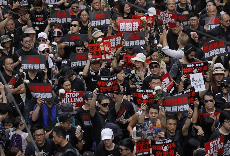 Protesters march on the streets against an extradition bill in Hong Kong on Sunday, June 16, 2019. Hong Kong residents Sunday continued their massive protest over an unpopular extradition bill that has highlighted the territory's apprehension about relations with mainland China, a week after the crisis brought as many as 1 million into the streets. (AP Photo/Vincent Yu)