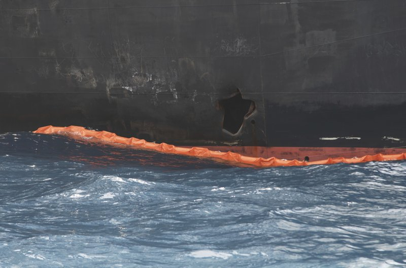A hole the U.S. Navy says was made by a limpet mine is seen on the damaged Panama-flagged, Japanese owned oil tanker Kokuka Courageous, anchored off Fujairah, United Arab Emirates, during a trip organized by the Navy for journalists, on a Wednesday, June 19, 2019. The limpet mines used to attack the oil tanker near the Strait of Hormuz bore
