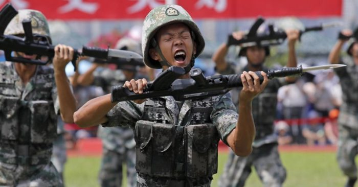 FILE - In this June 30, 2019 photo, soldiers from the People's Liberation Army of China (PLA) demonstrate their ability during an open day at Stonecutter Island Naval Base in Hong Kong to commemorate the 22nd anniversary of the handover of Hong Kong to China. (AP Photo / Kin Cheung)