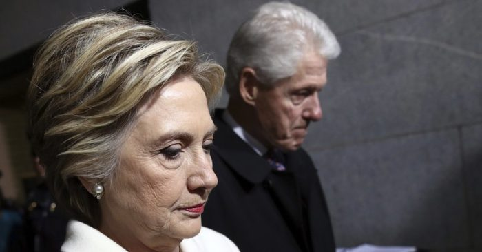 FILE - In this Jan. 20, 2017, file photo, former Sen. Hillary Clinton and former President Bill Clinton arrive on the West Front of the U.S. Capitol on Friday, Jan. 20, 2017, in Washington, for the inauguration ceremony of Donald J. Trump as the 45th president of the United States. (Win McNamee/Pool Photo via AP, File)