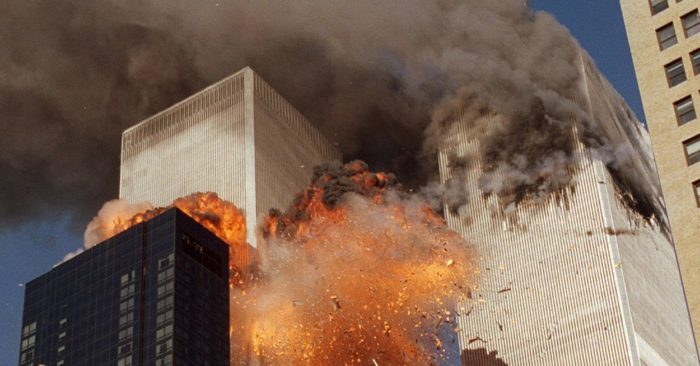 FILE - In this Sept. 11, 2001 photo, smoke can be seen coming out from one of the World Trade Center towers and flames are coming out from the second tower when it explodes (AP/Chao Soi Cheong Photo, Archive).