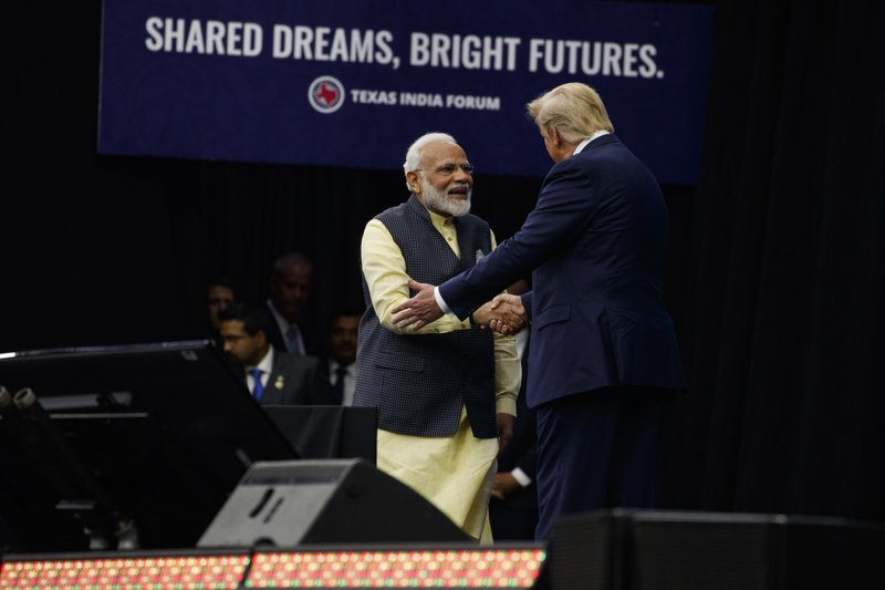 President Donald Trump shakes hands with Indian Prime Minister Narendra Modi during the