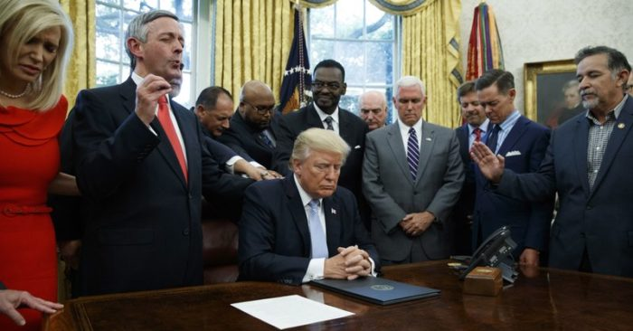 Evangelical leaders pray with President Donald Trump on Sept. 1, 2017, after he signed a proclamation for a national day of prayer to occur on Sunday, Sept. 3, 2017, in the Oval Office of the White House. (Evan Vucci/AP Photo, File)