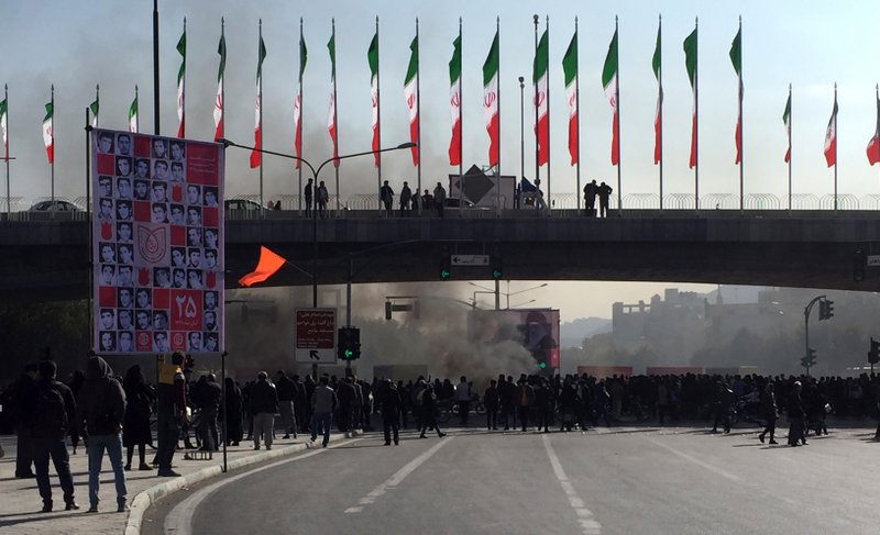 Smoke rises during a protest after authorities raised gasoline prices, in the central city of Isfahan, Iran, Saturday, Nov. 16, 2019. Demonstrators angered by a 50% increase in government-set gasoline prices blocked traffic in major cities and occasionally clashed with police Saturday after a night of demonstrations punctuated by gunfire. (AP Photo)