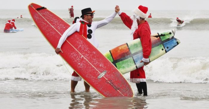 Surfing Santas ride waves along Florida's Space Coast