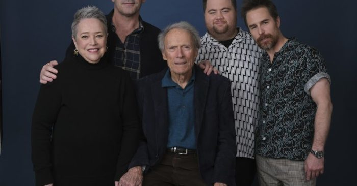 """Director Clint Eastwood, center, posing with cast members, from left, Kathy Bates, Jon Hamm, Paul Walter Hauser and Sam Rockwell during a shoot to promote his film """"Richard Jewell"""" at the Four Seasons Hotel in Beverly Hills, California. December 5, 2019. (Chris Pizzello/ Photo AP)"""