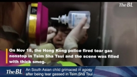 An South Asian child grimaced in agony after being tear gassed in Tsim Sha Tsui