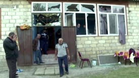 Four dead, 13 injured in Azeri village hit by shelling